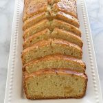sliced maple ginger pound cake on white serving tray