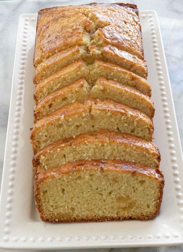 sliced maple ginger pound cake on white serving tray