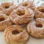 low carb glazed donuts on white cake stand