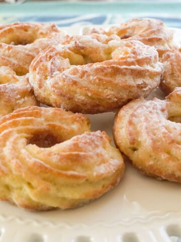 low carb glazed donuts on white cake stand.
