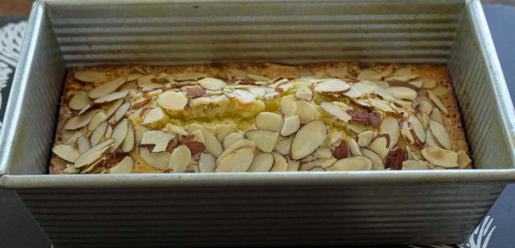 almond loaf cake in pan