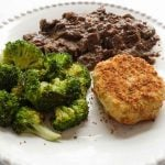 slow cooker sauerbraten with baked potato balls and broccoli on white plate