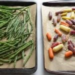 Roasted string beans and carrots on baking sheet