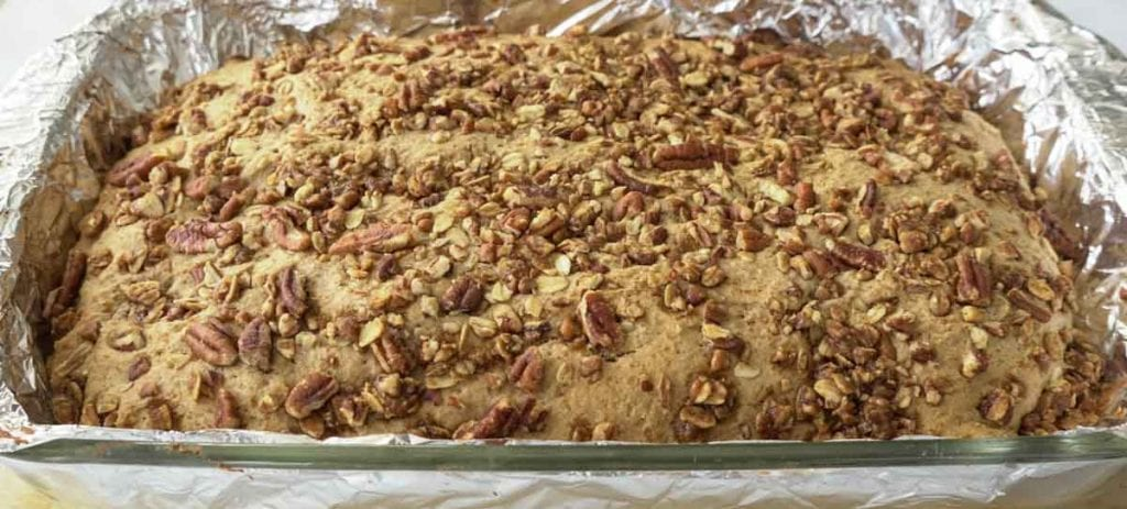 Baked refined sugar free pecan streusel cake in glass pan