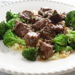 Beef and Broccoli with Cauliflower Rice on white plate