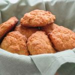 low carb biscuits in a basket with green napkin
