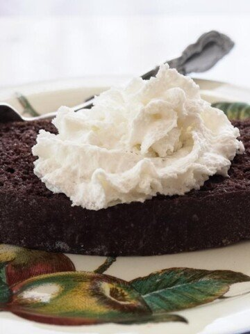 low carb chocolate quick bread with whipped topping on plate