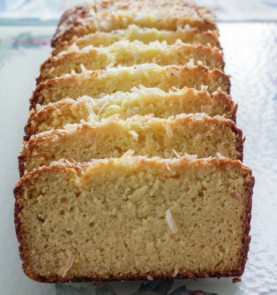 Baked slice of low carb coconut pound cake on glass tray