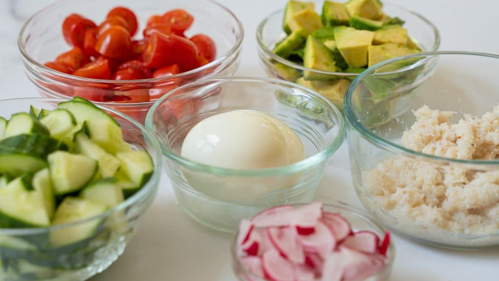 tomatoes, avocado, cucumber, radishes, hardboiled eggs, crabmeat