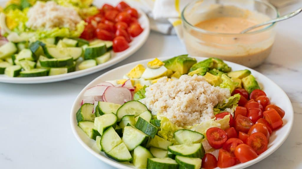 crab louie salad on plate and dressing in bowl