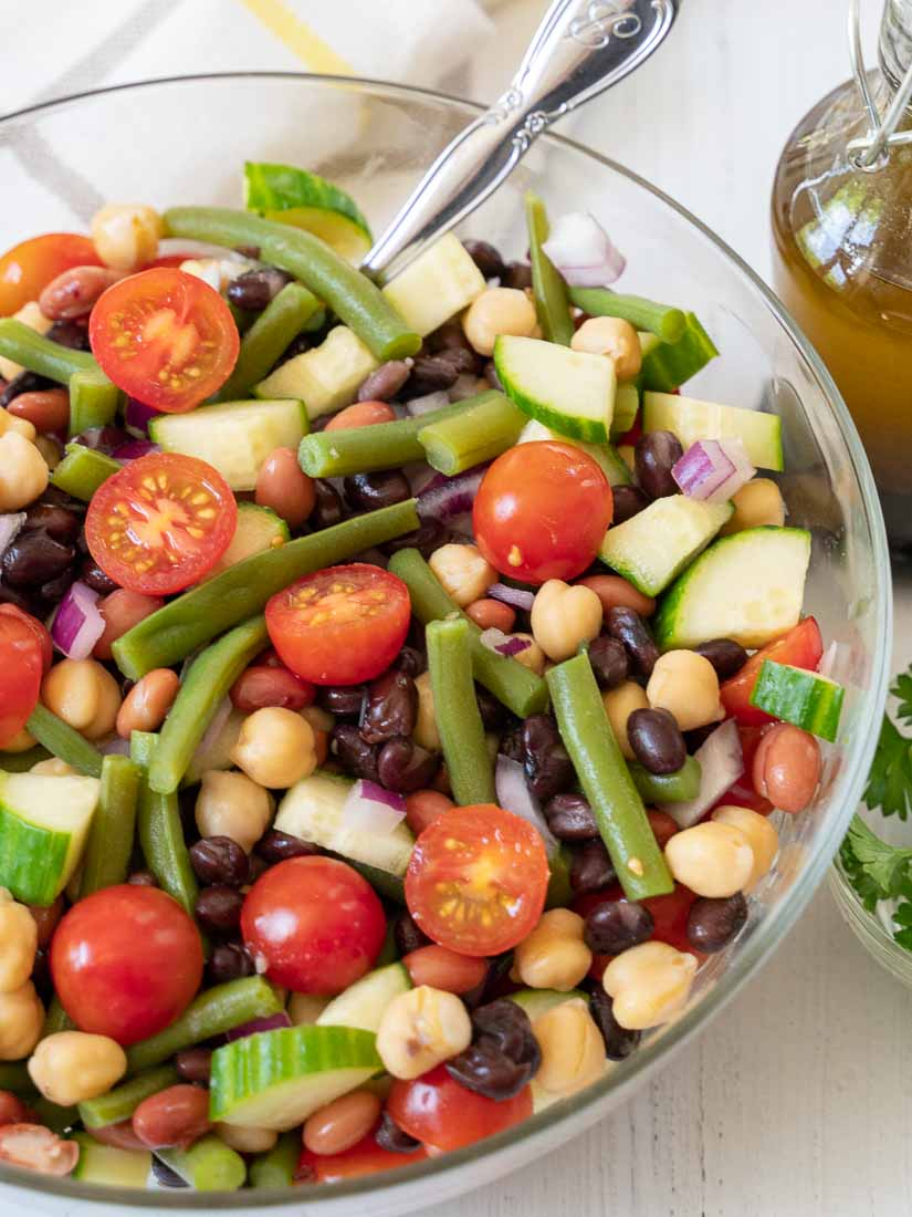 4 Bean Vegetable salad in bowl with balsamic vinaigrette and parsley