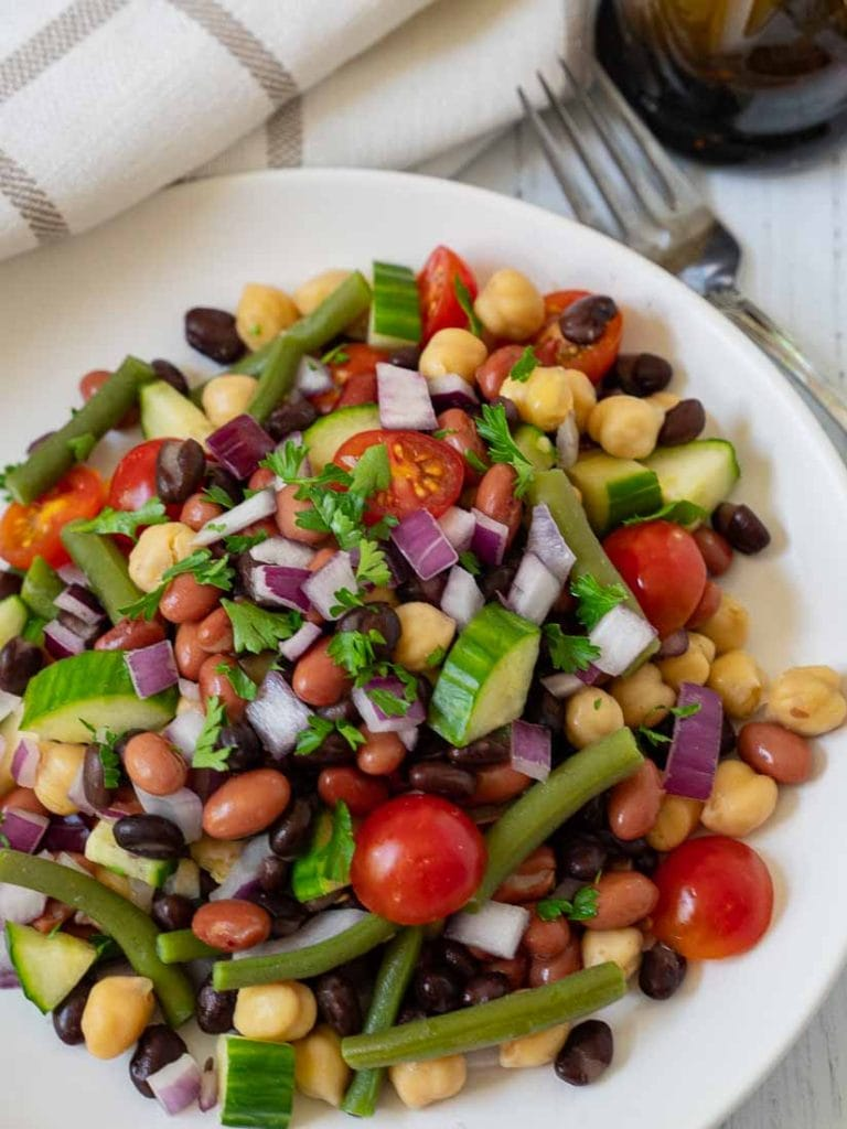 4 bean vegetable sald with balsmic vinaigrette and fork