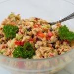 chicken salad with tarragon aioli in glass bowl