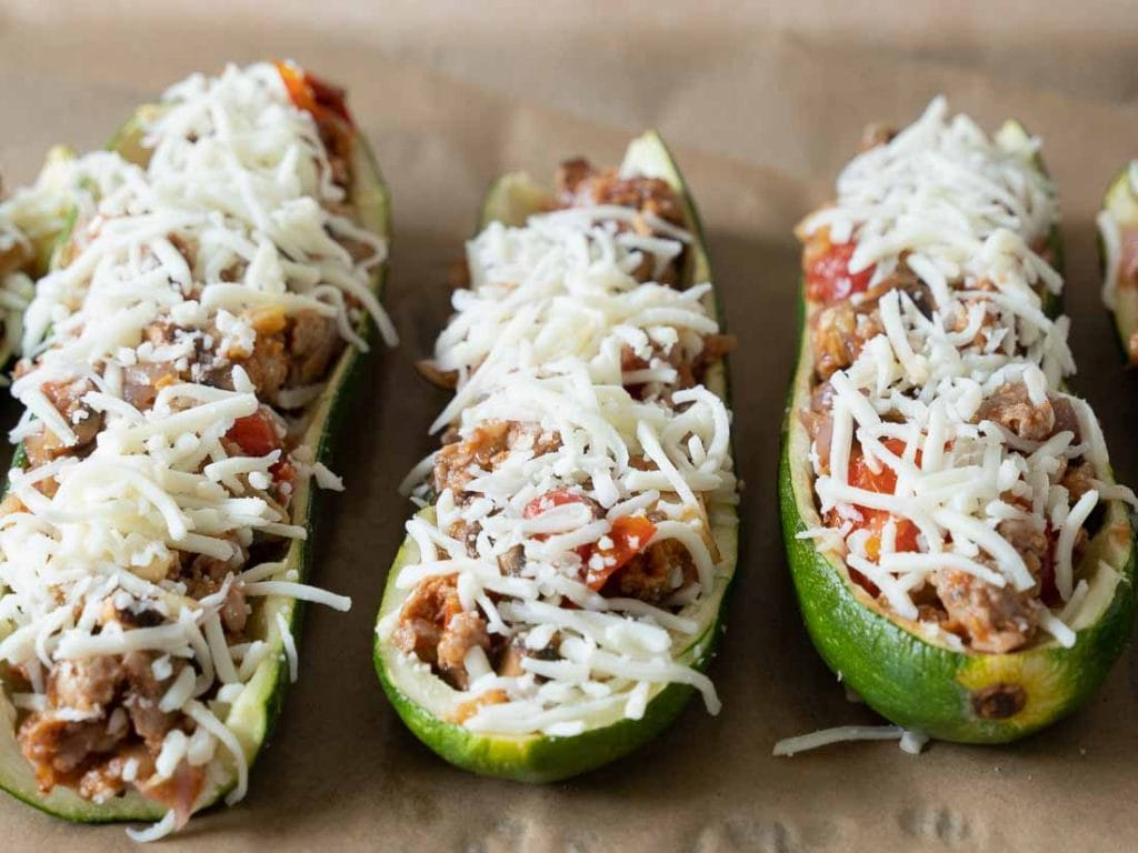 zucchini boats on parchment lined baking tray