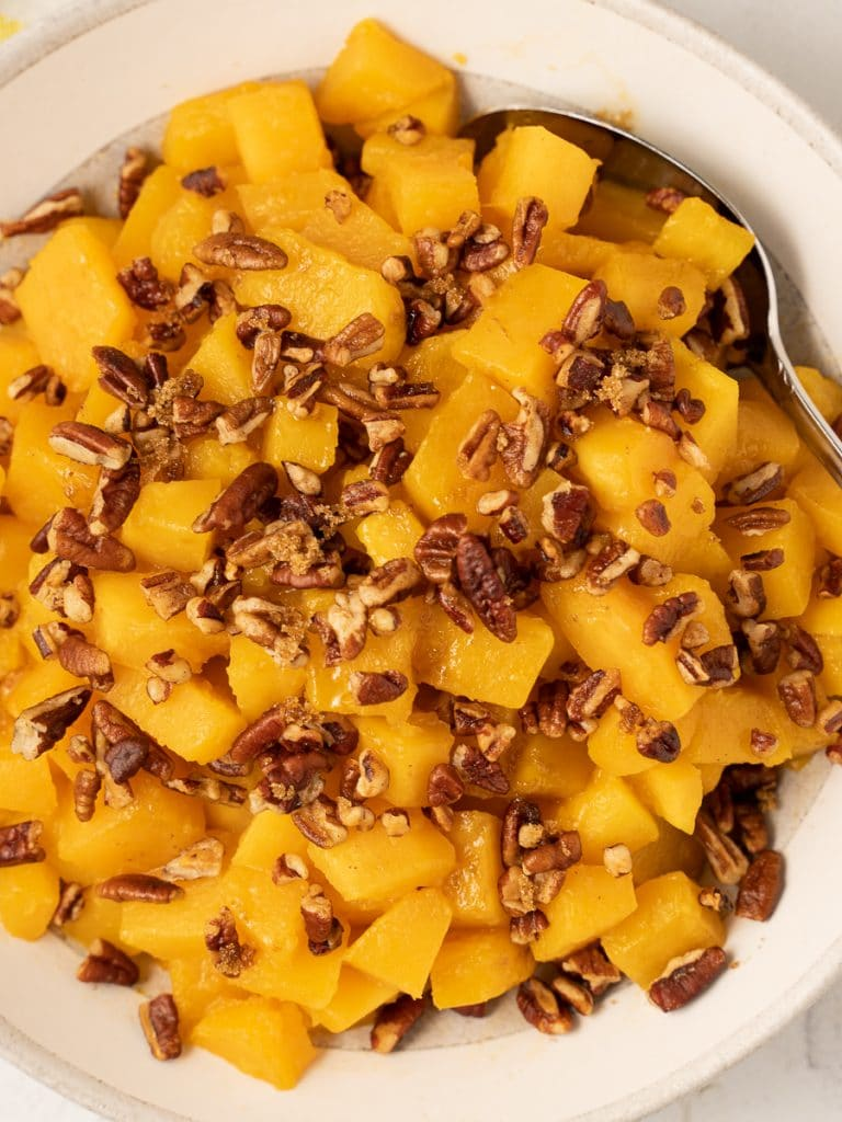 low carb butternut squash  with pecans in white bowl