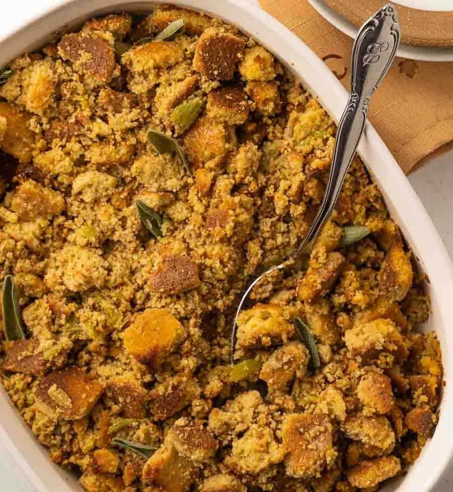 keto stuffing in a white casserole dish with serving spoon