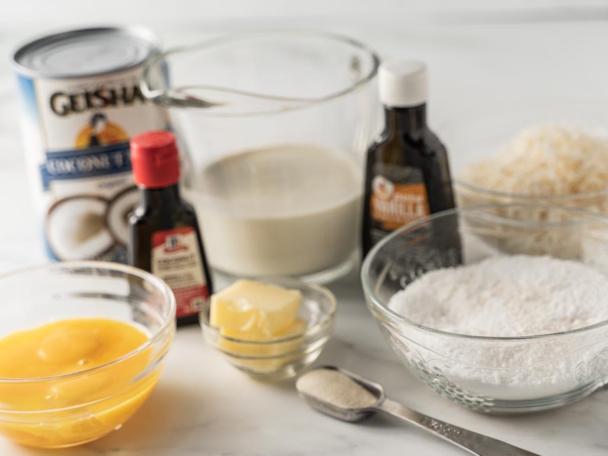 unsweetened coconut milk, heavy cream sugar substitute, egg yolks, vanilla, coconut extracts, butter