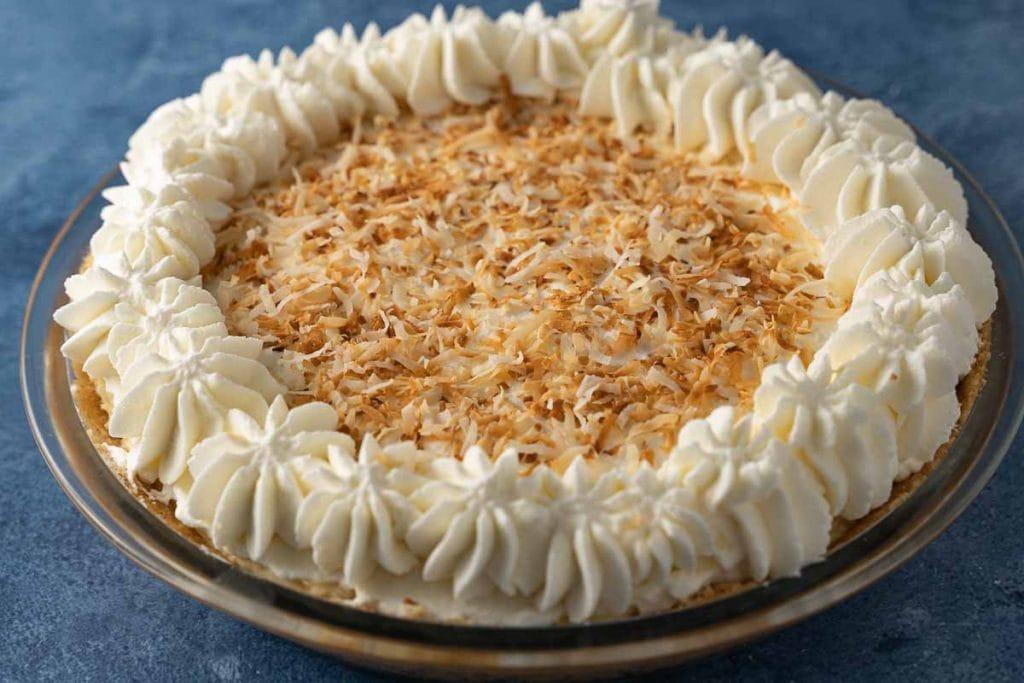 keto coconut cream pie in glass pie plate