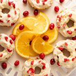 keto cranberry donuts with orange slices on white platter