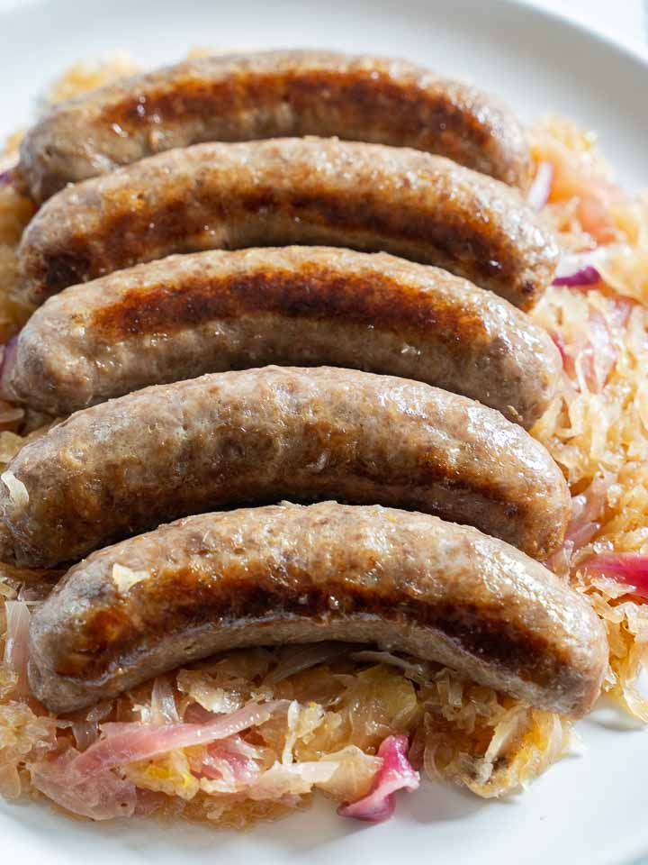 beer brats with red onions and sauerkraut