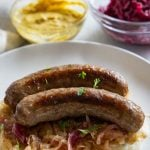Instant pot brats with red onion, sauerkraut and mashed cauliflower