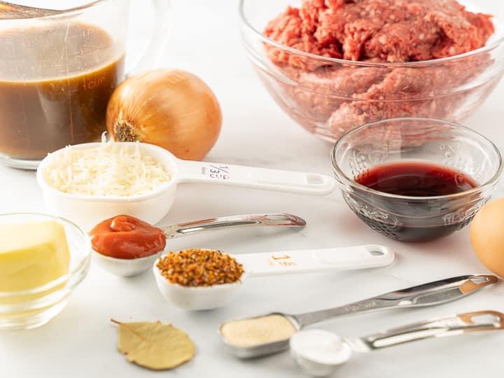 ground chuck, wine, beef broth, seasonings, egg, parmesan cheese, onion, ketchup