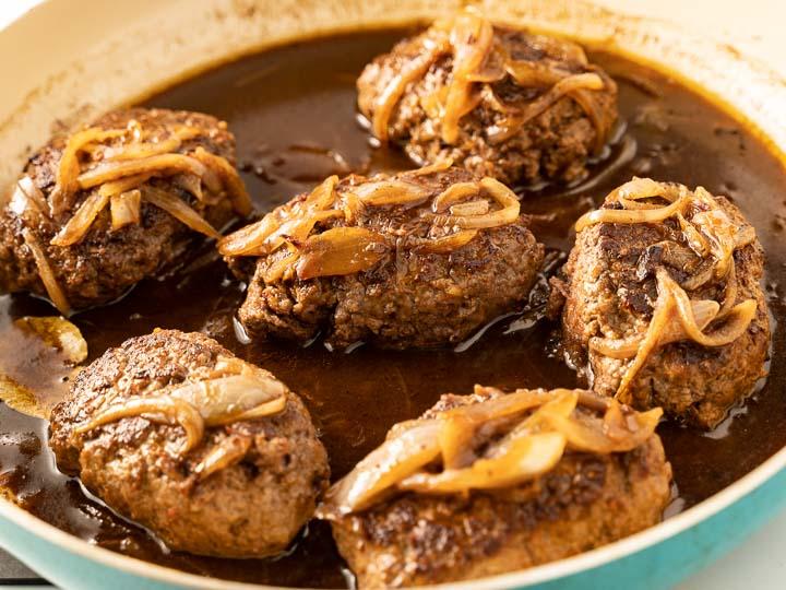 salisbury steak, onions and red wine gravy in pan