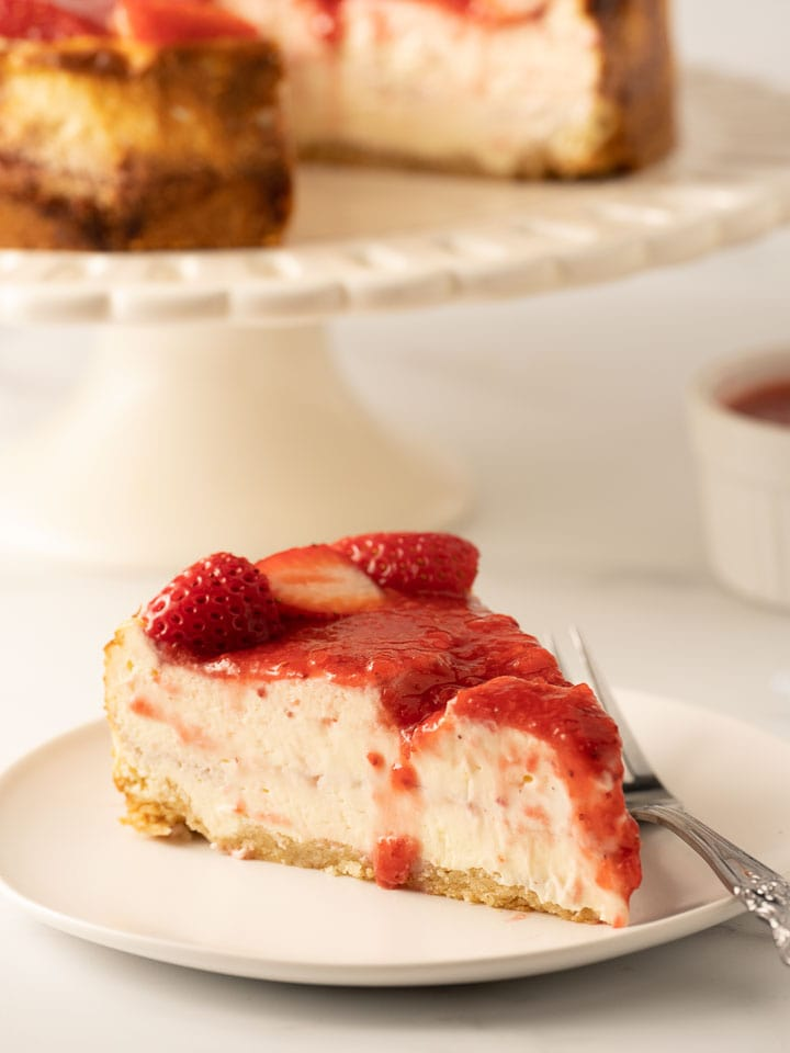 keto strawberry cheesecake on white plate with fork