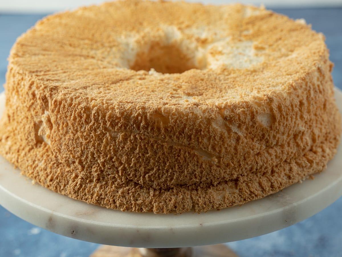 keto angel food cake on cake pedestal
