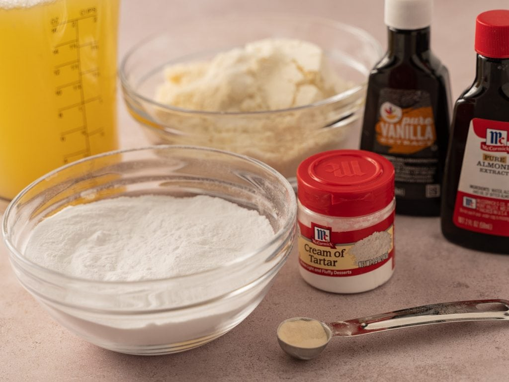egg whites, almond flour, arrowroot powder, cream of tartar, almond, vanilla extracts, sugar substitute