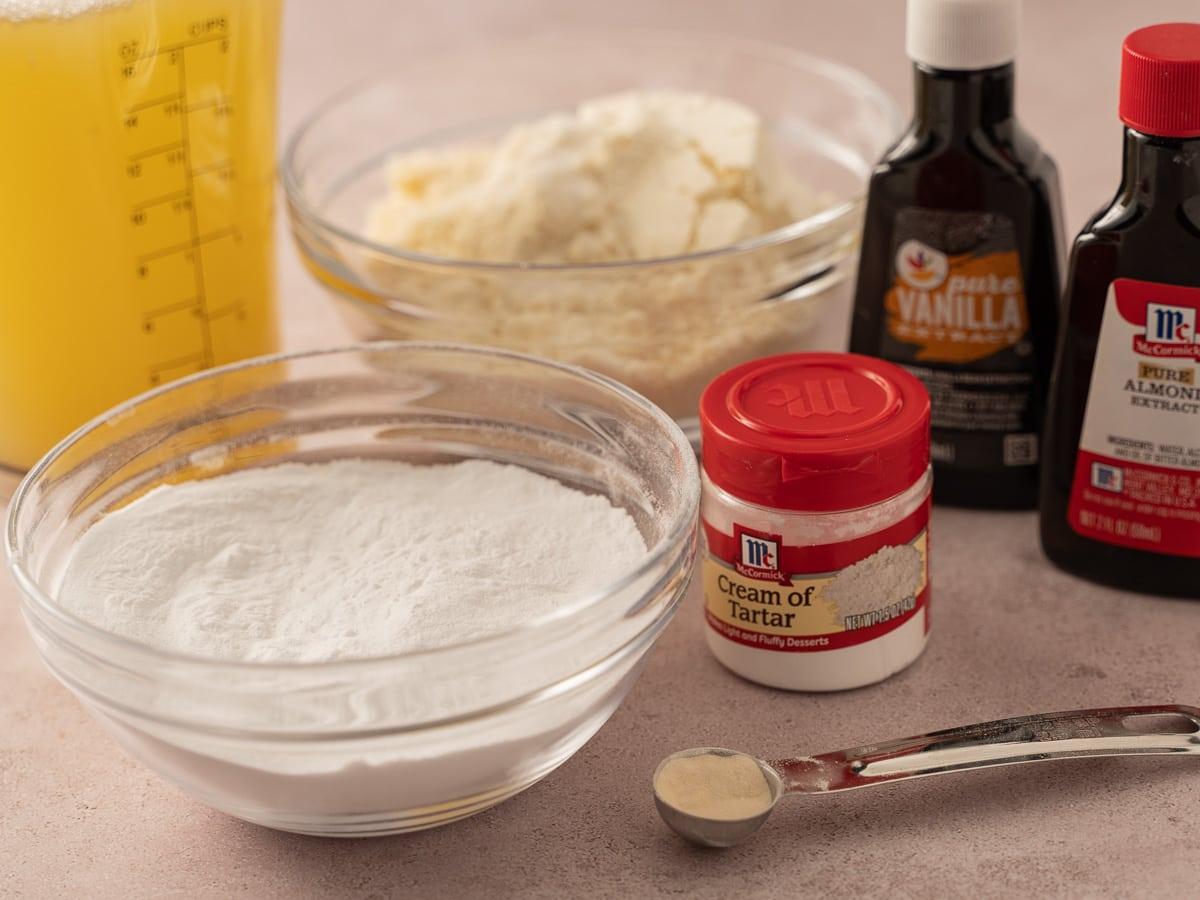 egg whites, almond flour, arrowroot powder, cream of tartar, almond, vanilla extracts, sugar substitute
