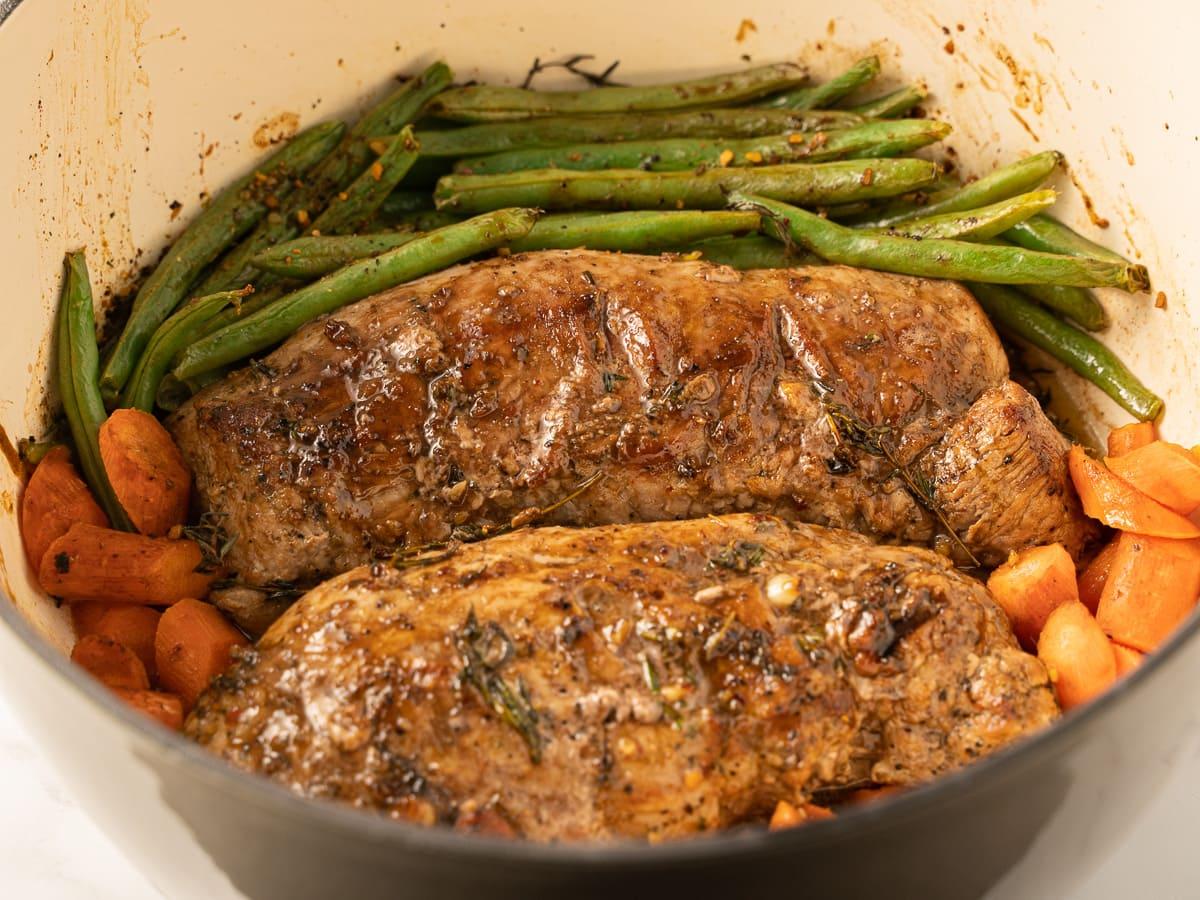 keto pork tenderloin in dutch oven with carrots, string beans