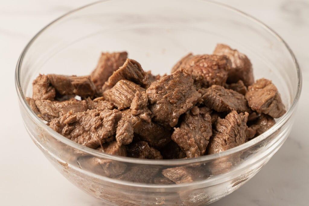 fried flank steak in bowl