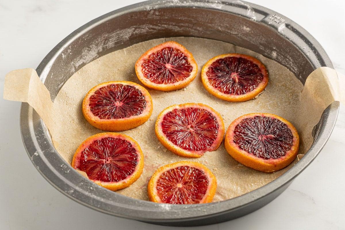 blood orange slices in bottom of cake pan