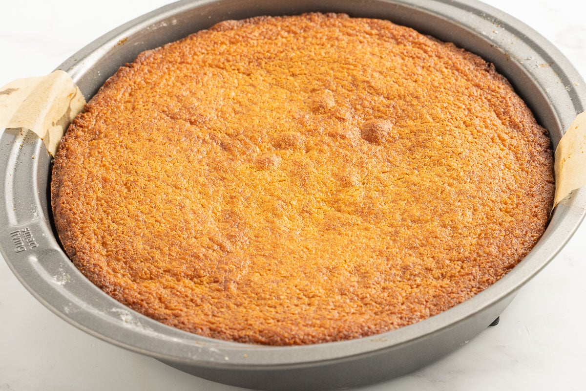 cake in pan with parchment