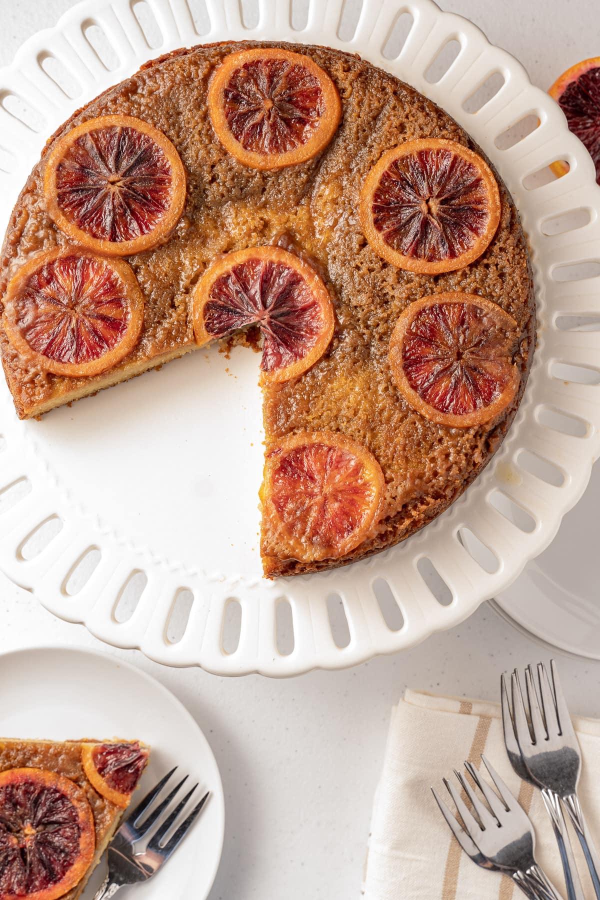 keto upside down orange cake on white platter