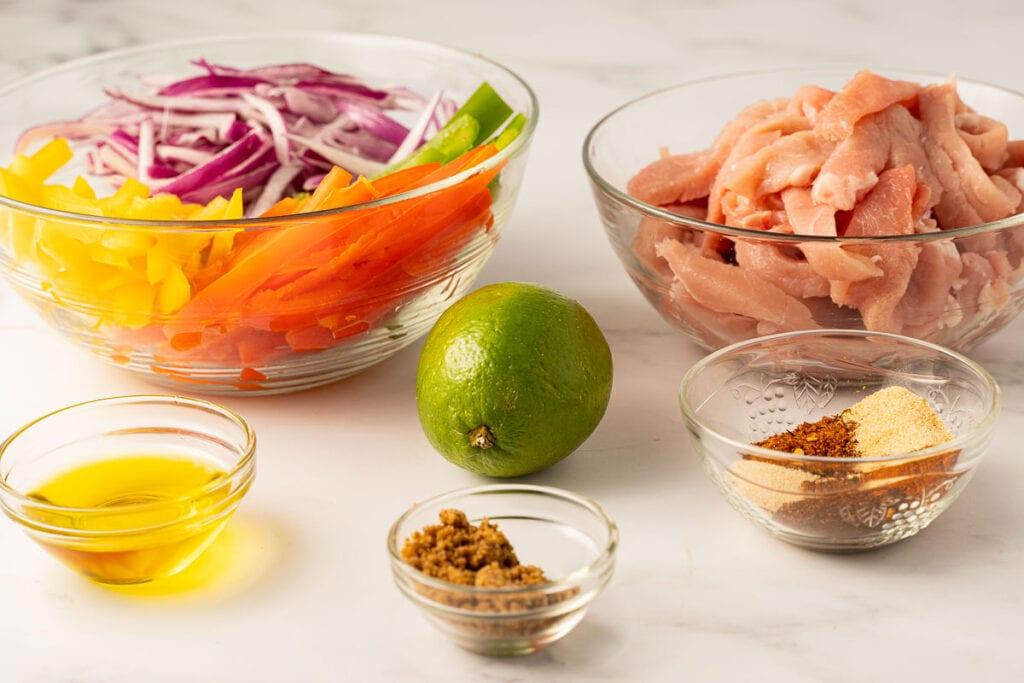 fajita seasonings, lime, sliced pork, onions and bell peppers