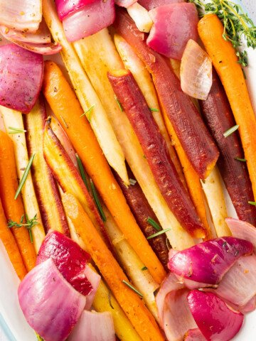 roast carrots and onions on white platter