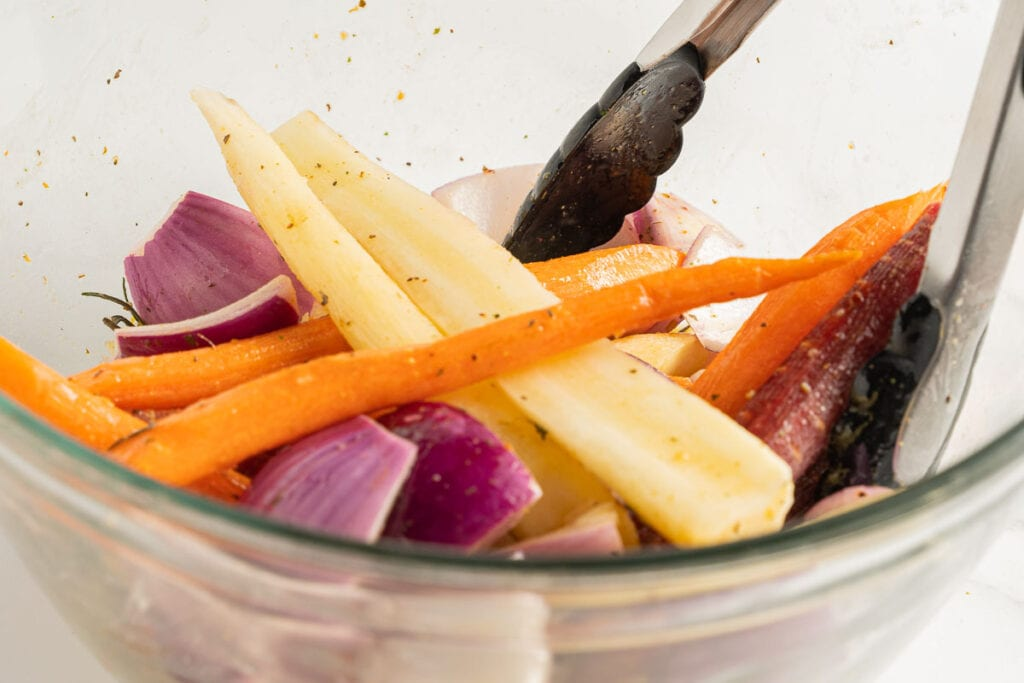 carrots and onions marinating in glass bowl