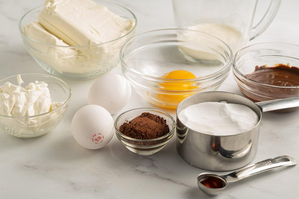cream cheese, eggs, cocoa, sugar substitute, heavy cream, sour cream, vanilla