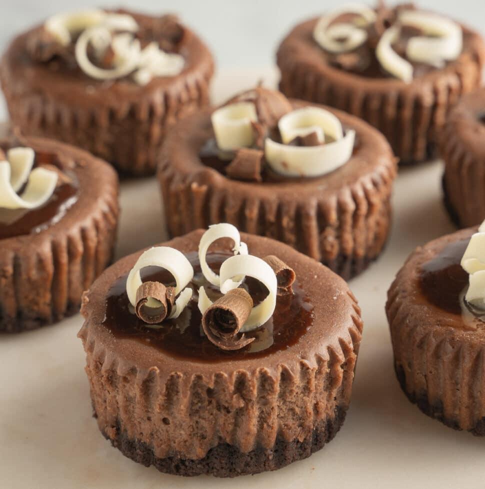 keto mini chocolate cheesecakes on white plate