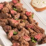 steak bites on platter and blue cheese in bowl