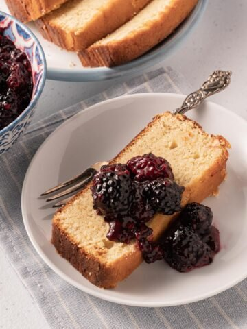 blackberry compote and poundcake on white plate