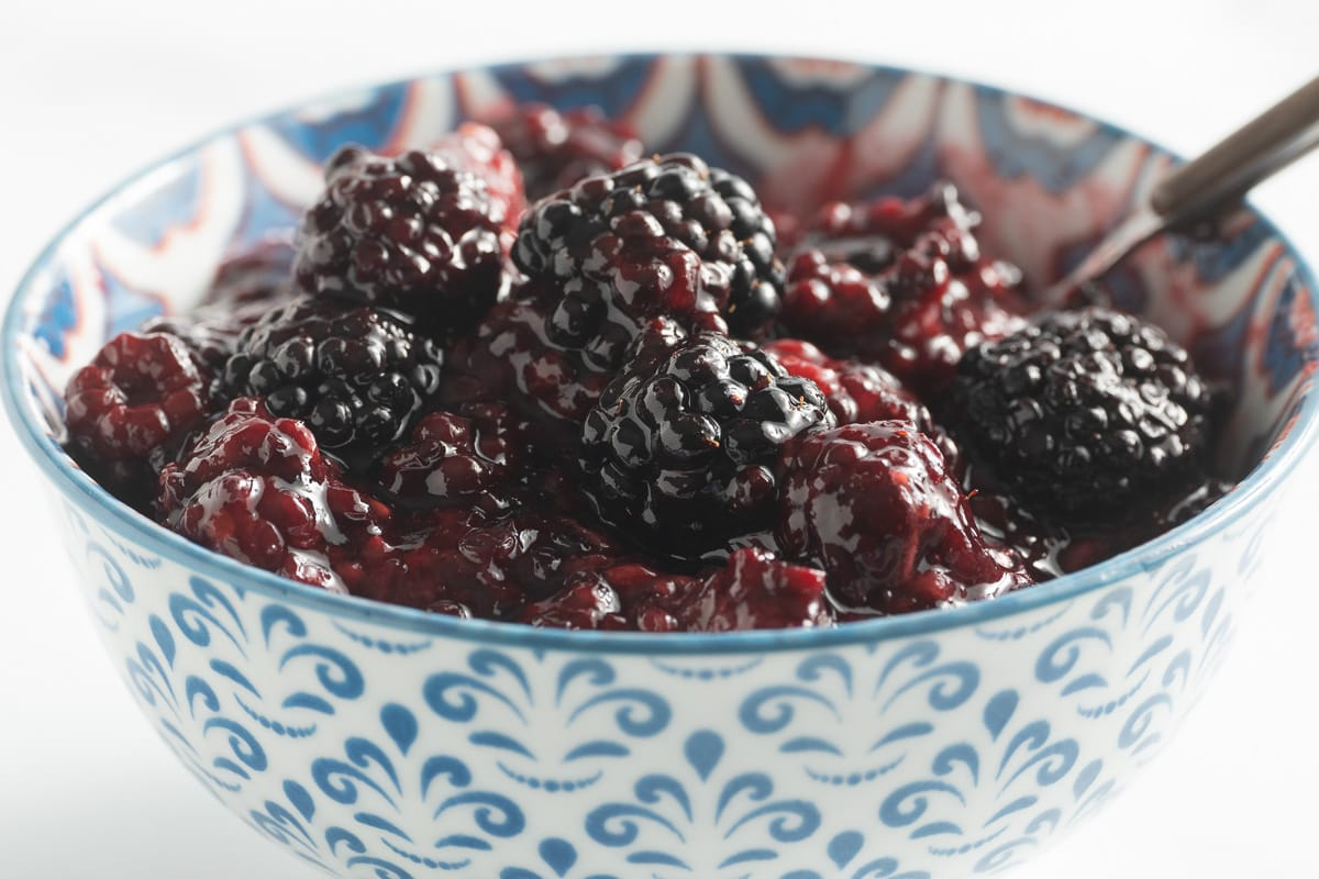 blackberry compote in blue bowl