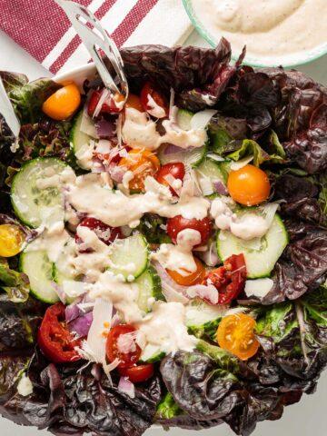 garlic dressing on red lettuce salad