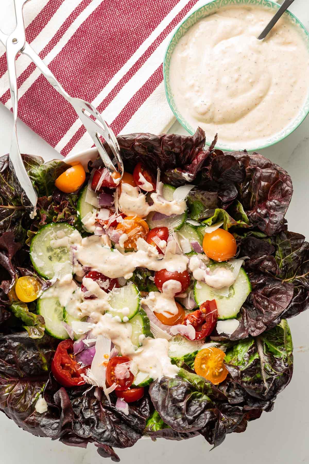 garlic dressin on red lettuce salad