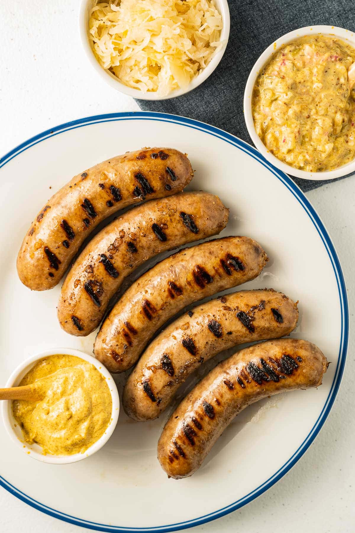 grilled bratwurst on plate with mustard