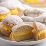 donuts filled with lemon curd on white plate