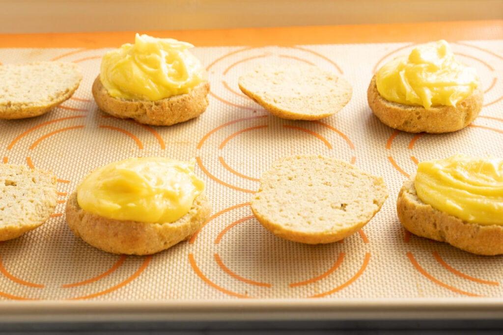 lemon curd on donut halves