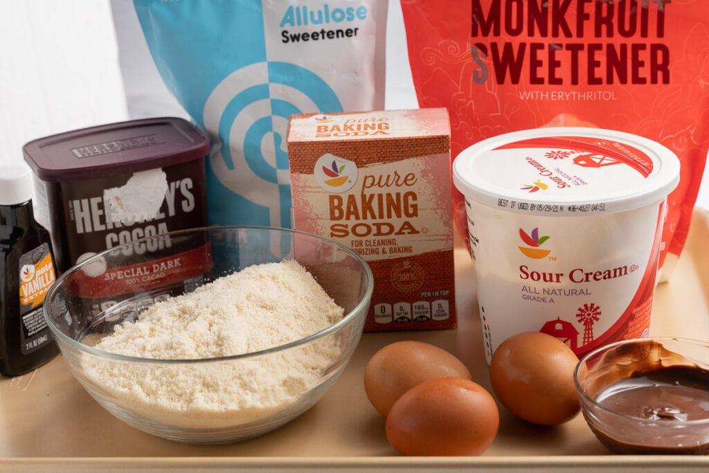 almond flour, sugar substitute, cocoa powder eggs, sour cream, baking soda, melted chocolate